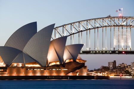utzon: SYDNEY - FEBRUARY 6: The Sydney Opera House with Harbor bridge in Sydney, Australia on February 6, 2013. Designed by Danish architect Jorn Utzon; this year is celebrating the 40th opening anniversary Editorial