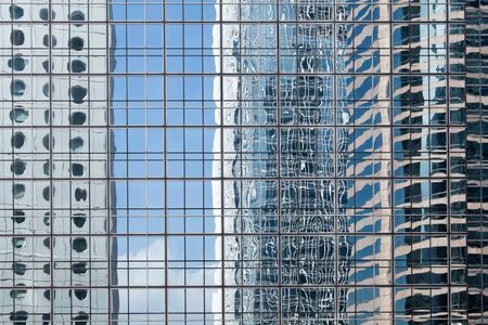 HONG KONG - FEBRUARY 1, 2013: Reflections in glass-metal facade of skyscraper in Hong Kong downtown.