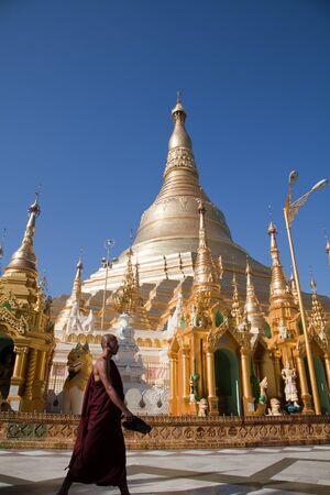 man made structure: Monks in the biggest Buddhist temple Shwedagon pagoda, Rangoon, Burma.