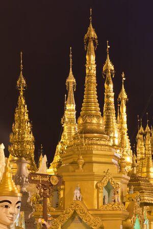 man made structure: Interior of the biggest Buddhist temple Shwedagon pagoda at night lighting, Rangoon, Burma.