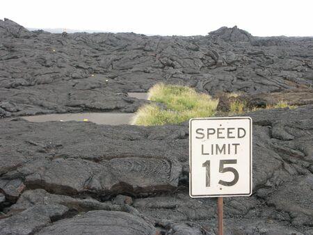 lava field: Volcano lava field with traffic sign.