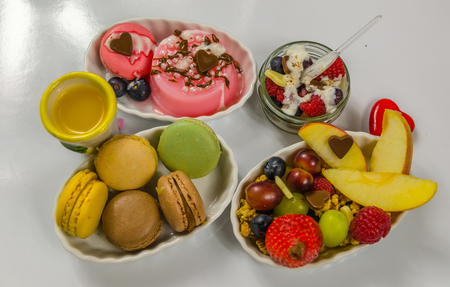 set of different desserts, macarons, fruit and puddings, sweet Stock Photo