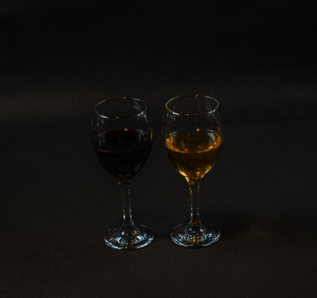 red and white wine in the glass, on a black background, wineglass, drink set