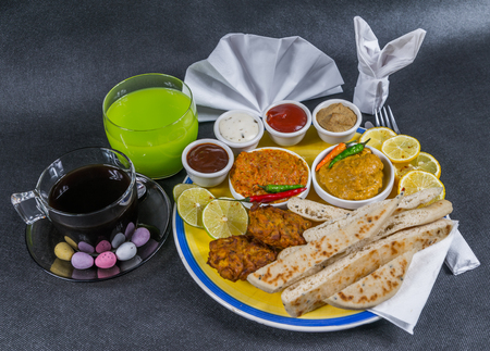 Oriental Indian set, chicken korma, chicken tikka masala, naan bread, onion bhaji, plate, coffee, drink, napkin, peppers, four sauces, tasty set Stock Photo