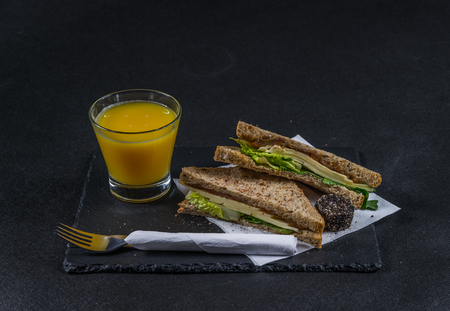malted: set consisting of two sandwiches malted bread with vintage cheddar cheese, pickles, red onion, tomato, lettuce, orange juice, tasty set Stock Photo