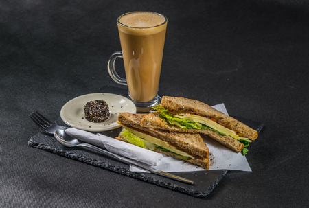 malted: set consisting of two sandwiches  malted bread with vintage cheddar cheese, pickles, red onion, tomato, french cheese, lettuce, coffee latte, tasty set