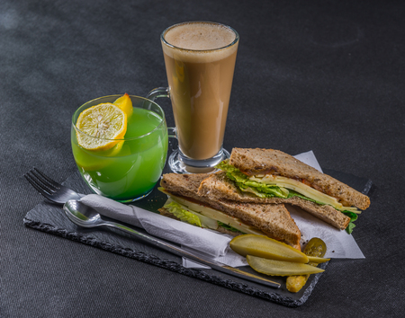 malted: set consisting of two sandwiches malted bread with vintage cheddar cheese, pickles, red onion, tomato, lettuce, green drink and coffee latte, tasty set
