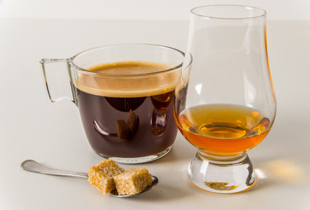 aroma black coffee in modern glass cup, white background, teaspoon, single malt, white background