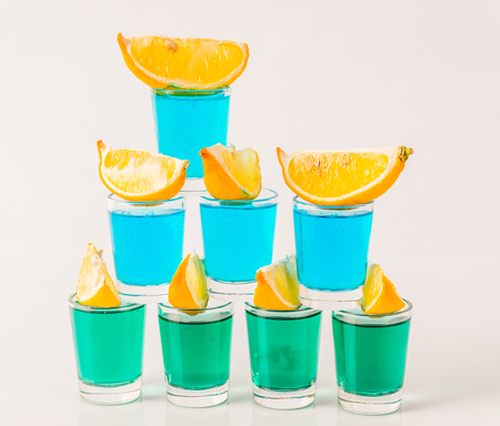 Glasses with blue and green kamikaze, glamorous drinks, mixed drink poured into shot glasses, party set Stock Photo