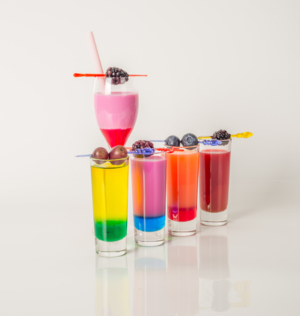 red straw: Colorful set of drinks, color drink decorated with fruit, color shots, party set Stock Photo