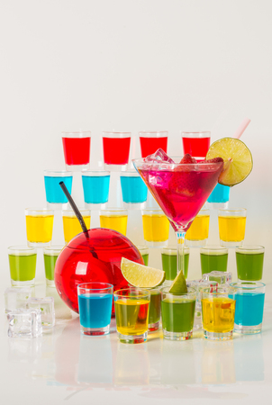 Colorful set of drinks, color drink decorated with fruit, many color kamikaze drink, shot drinks, party set Stock Photo