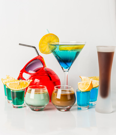 Colorful drink in a martini glass, blue and green combination, nine drinks in a shotglass, drinks set, party set