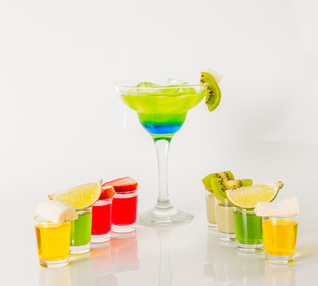 Colorful drink in a margarita glass, blue and green combination, many drinks in a shotglass, party set Stock Photo