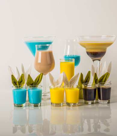 Colorful drinks based on milk liqueurs, unique pastel colors of drinks, bunny napkin, spring drinks