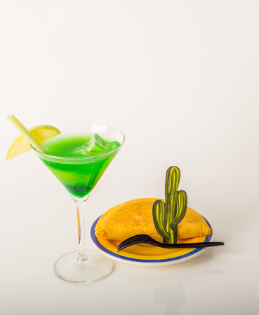 drink decorated with fruit, martini glass, drink staw and ice cubes, jamaican food, pattie, summer set
