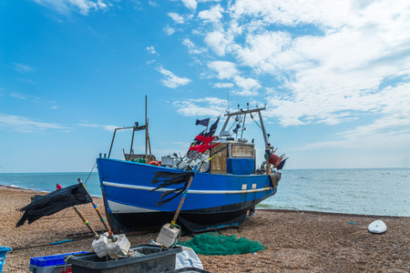 Fishing boats on the shore, pebble beach, wooden boats, fishing and tourist industry, seaside town