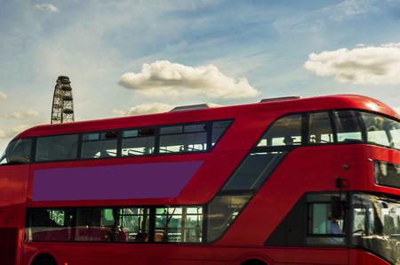 Double deck red bus on the bridge in London, symbolic vehicle on the bridge, London
