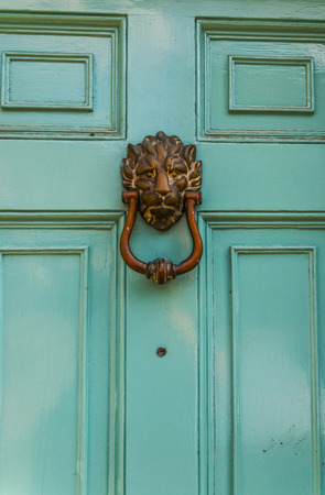 Door with brass knocker in the shape of a lions head beautiful entrance to the & Old Vintage English Style Red Salmon Pink Front Door With Age ...