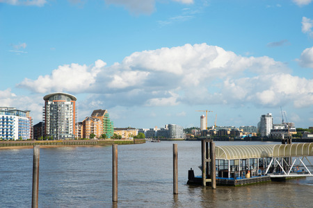 Wide river canal, city skyline, residential buildings on the other side of the shore, beautiful district, architecture