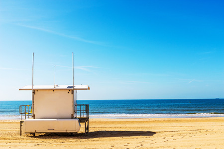 White rescue hut on a sandy beach, safe relax by the ocean, a beautiful sunny day, vacation Stock Photo