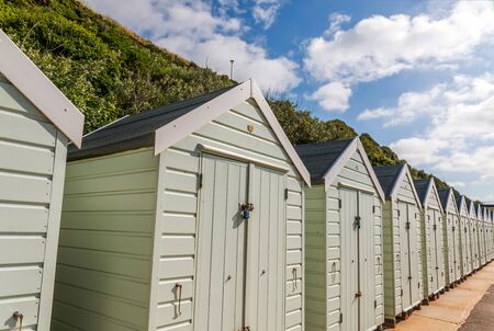 white houses on the beach, whitel door to summer cottages, seaside spot, vacation