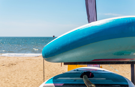 based: Sandy beach, color kayaks based on stand, in background beautiful view on blue ocean, sunny day Stock Photo