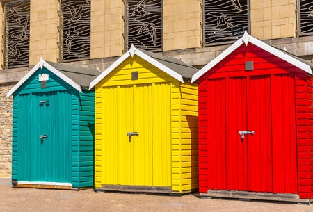 Colored houses on the beach, colorful door to summer cottages, seaside spot, vacation