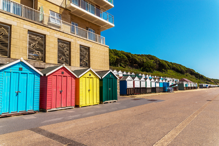 sunburnt: Colored houses on the beach, colorful door to summer cottages, seaside spot, vacation