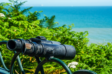 Metal ornament on a balustrade in a seaside town, symbolic in the shape of binoculars, decor