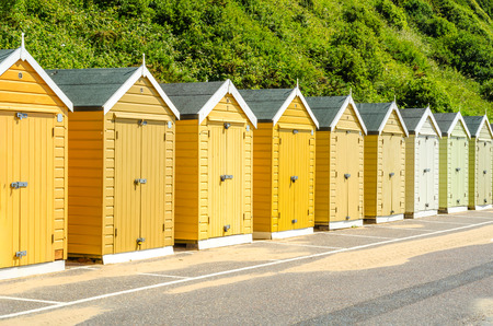 Colored houses on the beach, colorful door to summer cottages, seaside spot, sunny day Stock Photo