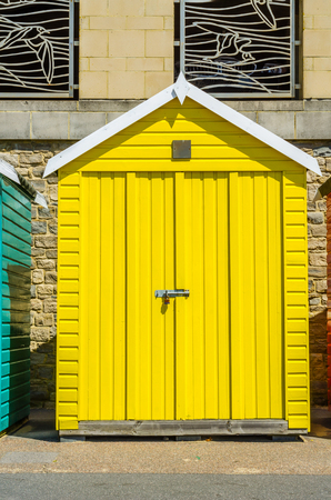 yellow house on the beach, colorful door to summer cottages, seaside spot, sunny day