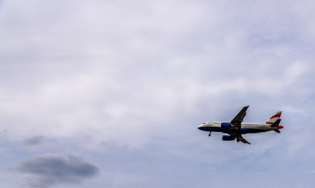 Passenger plane flying in the blue sky with clouds, cruise aircraft, transport industry, aviation