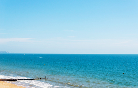Sandy beach and blue ocean, beautiful sunny day, place of rest Stock Photo