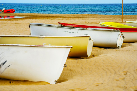 boat on the sand, beautiful sandy beach, boat for leisure and fishing, sunny day Stock Photo