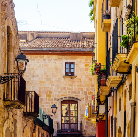 Charming narrow street, street with colorful facades of buildings, vintage style, sunny day