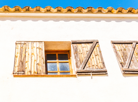 window shutters on an old european style building, architectural decoration old windows, vintage style, a protective element of windows, interesting detail Stock Photo