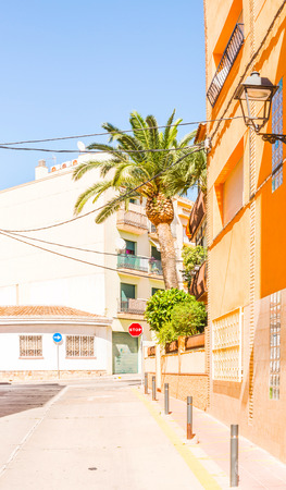 beautiful, picturesque street, narrow road, colorful facades of buildings, Spanish architecture, sunny day Stock Photo