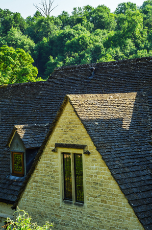 Roofs of buildings covered with sar roof tile, beautiful English architecture, old roofs, vintage Stock Photo