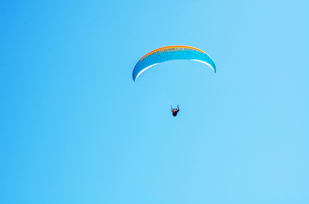 Paraglider flying in the sky, free time spent actively, wonderful experiences, vacation