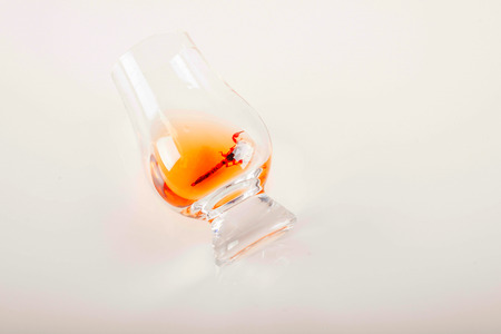 single malt tasting glass with scorpion, single malt whisky in a glass, black  background, party