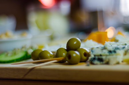 set of different cheeses on a wooden board, cheese board, delicious snack, healthy and exclusive food, cheese set Stock Photo
