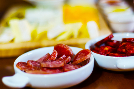 set of traditional Spanish sausages, side dishes of thinly sliced different chorizo, sets of meats, tasty meal Stock Photo