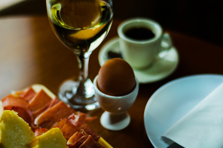 Breakfast set with egg in egg-cup, fresh bread, healthy and tasty food in the morning, breakfast
