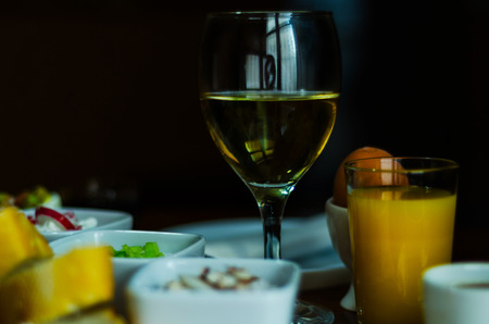 white wine in a glass with appetizers on a wooden table, a set of starters, relax with a glass of wine, white wine