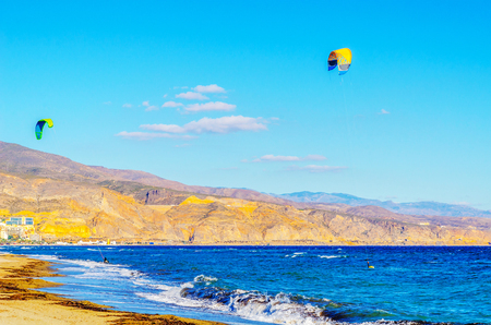 kitesurfer on sea waves, water extreme sport, active sport, adventure and freedom, windsurfing