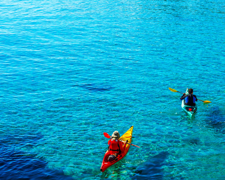 Senior kayaker on a kayak by the sea, active water sport and leisure, kayaking