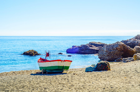 Old boat on the shore on the sand, vacation, beach for tourists, sunny day Stock Photo