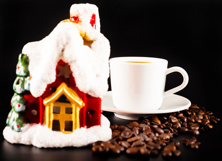 black coffee in a white cup and candlestick Christmas house, drink set, tasty drink