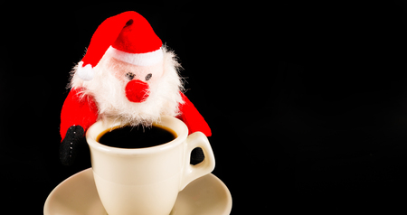 black coffee in a white cup and plush Santa Claus, drink set, tasty drink