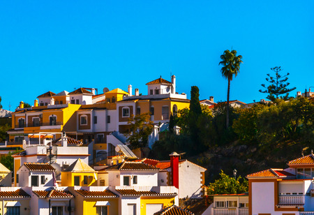 typical town architecture in Andalusia, characteristic building facades, tourist place, sunny day Foto de archivo